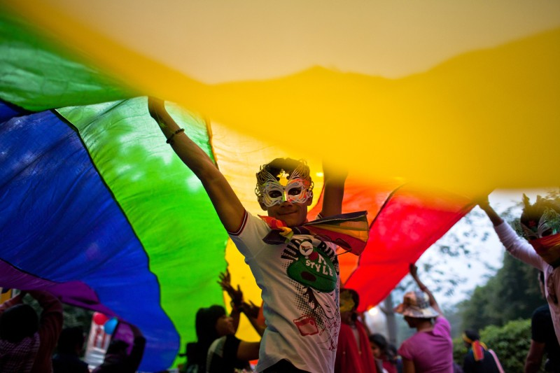 NEW DELHI, INDIA - NOVEMBER 27:  A boy dances as he and others participate during the 4th Delhi Queer Pride 2011 March on November 27, 2011 in New Delhi, India.  India's Lesbian, Gay, Bisexual and Transgender (LGBT) community celebrated the 4th Delhi Queer Pride March with a parade through the streets of Delhi. People gathered to protest violence, harassment and discrimination faced by the LGBT community in India.  (Photo by Daniel Berehulak/Getty Images)