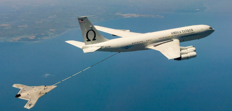 150422-N-CE233-457 PATUXENT RIVER, Md. (April 22, 2015) The Navy's unmanned X-47B receives fuel from an Omega K-707 tanker while operating in the Atlantic Test Ranges over the Chesapeake Bay. This test marked the first time an unmanned aircraft refueled in flight. (U.S. Navy photo/Released)