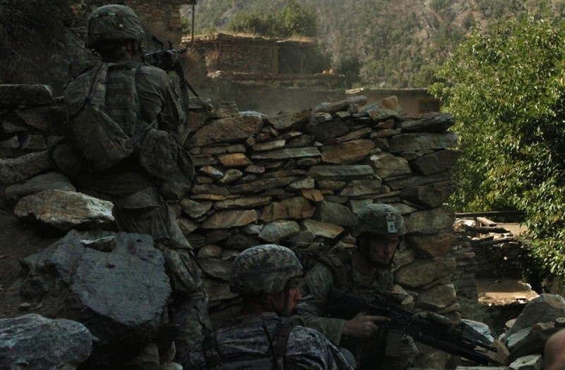 U.S. Army and Air Force personnel assigned to Company B, 2nd Battalion, 12th Infantry Regiment, 4th Brigade Combat Team, 4th Infantry Division, return fire at insurgent positions in the Korengal valley's steep hillside in Afghanistan's Kunar province, Aug. 13. The 20 minute gun battle ended with 500 pound bombs, dropped by U.S. Air Force F-15 fighter jets, destroying insurgent positions in the surrounding hills., no civilians were injured during the battle. International Security Assistance Forces across Afghanistan have increased operations in recent months, in order to ensure safety and security during Afghanistan's second national election, scheduled for the end of August.