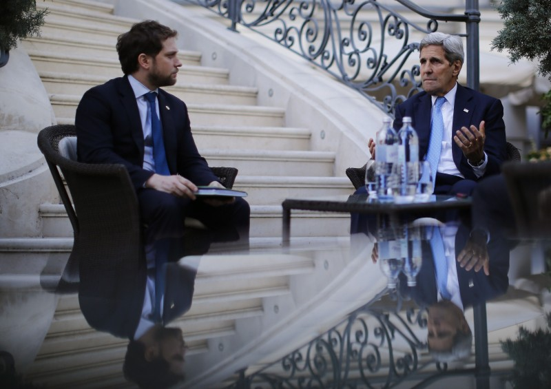 "US Secretary of State John Kerry and State Department Chief of Staff Jon Finer (L) meet with members of the US delegation at the garden of the Palais Coburg hotel where the Iran nuclear talks meetings are being held in Vienna, Austria July 10, 2015. Iran accused major powers on Friday of backtracking on previous pledges and throwing up new ""red lines"" at nuclear talks, after the deadline to reach an agreement in time to receive expedited scrutiny from the US Congress expired with no deal. AFP PHOTO / POOL / CARLOS BARRIA        (Photo credit should read CARLOS BARRIA/AFP/Getty Images)"