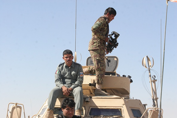 HERAT, AFGHANISTAN - OCTOBER 26: Afghan soldiers inspect an area after the Afghan security forces clashed with the Taliban militants in the Helmand Province, Afghanistan on October 26, 2015. At least 230 Taliban Militants and 27 Afghan soldiers killed during the ongoing clashes for 6 days. (Photo by Abdul Hadi Roshan /Anadolu Agency/Getty Images)