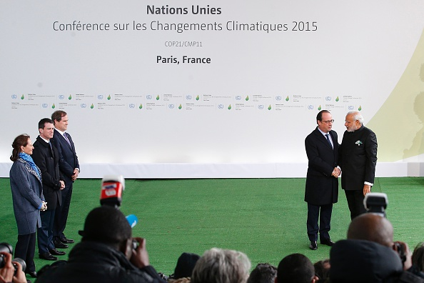 French President Francois Hollande (2-R) greets India's Prime Minister Narendra Modi (R), as French Minister for Ecology, Sustainable Development and Energy Segolene Royal (L) and France's Prime Minister Manuel Valls (2-L) look on, during the arrivals for the COP21 United Nations Climate Change Conference on November 30, 2015 in Le Bourget, outside Paris. More than 150 world leaders are meeting under heightened security, for the 21st Session of the Conference of the Parties to the United Nations Framework Convention on Climate Change (COP21/CMP11), also known as Paris 2015 from November 30 to December 11. AFP PHOTO / POOL / CHRISTOPHE ENA / AFP / POOL / CHRISTOPHE ENA        (Photo credit should read CHRISTOPHE ENA/AFP/Getty Images)