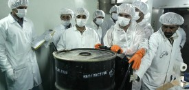 Iranian technicians remove a container of radioactive uranium, 'yellow cake', sealed by the International Atomic Energy Agency, to be used at the Isfahan Uranium Conversion Facilities (UCF), 420 kms south of Tehran, 08 August 2005. Iran looked set to resume sensitive nuclear fuel work imminently after the arrival of UN inspectors at a uranium conversion plant, a move that would put it on a collision course with the West.       AFP PHOTO/BEHROUZ MEHRI (Photo credit should read BEHROUZ MEHRI/AFP/Getty Images)