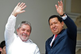 Venezuelan President Hugo Chavez (R) and Brazil's Luiz Inacio Lula da Silva wave during the South America-Africa (ASA) Strategic Presidential Committee, in Caracas, August 6, 2010. AFP PHOTO/Miguel Gutierrez (Photo credit should read MIGUEL GUTIERREZ/AFP/Getty Images)