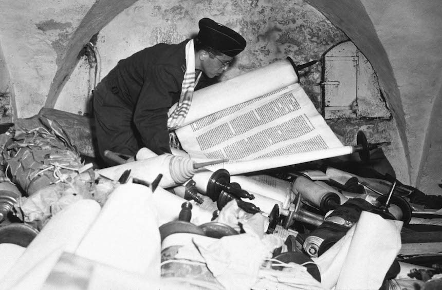 A US soldier inspects priceless art taken from jews by the Nazi's and stashed in the Heilbron Salt Mines May 3, 1945 in Germany. The treasures were uncovered by allied forces after the defeat of Nazi Germany.