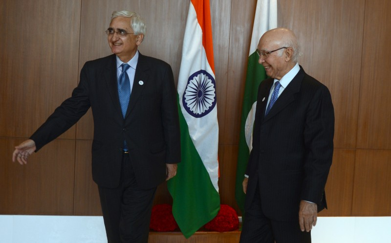 Indian Minister for External Affairs Salman Khurshid (L) welcomes Pakistan Foreign Minister Sartaj Aziz (R) prior to a meeting in Gurgaon on the outskirts of New Delhi on November 12, 2013.  Aziz is in India for a three-day official visit.  AFP PHOTO/RAVEENDRAN        (Photo credit should read RAVEENDRAN/AFP/Getty Images)