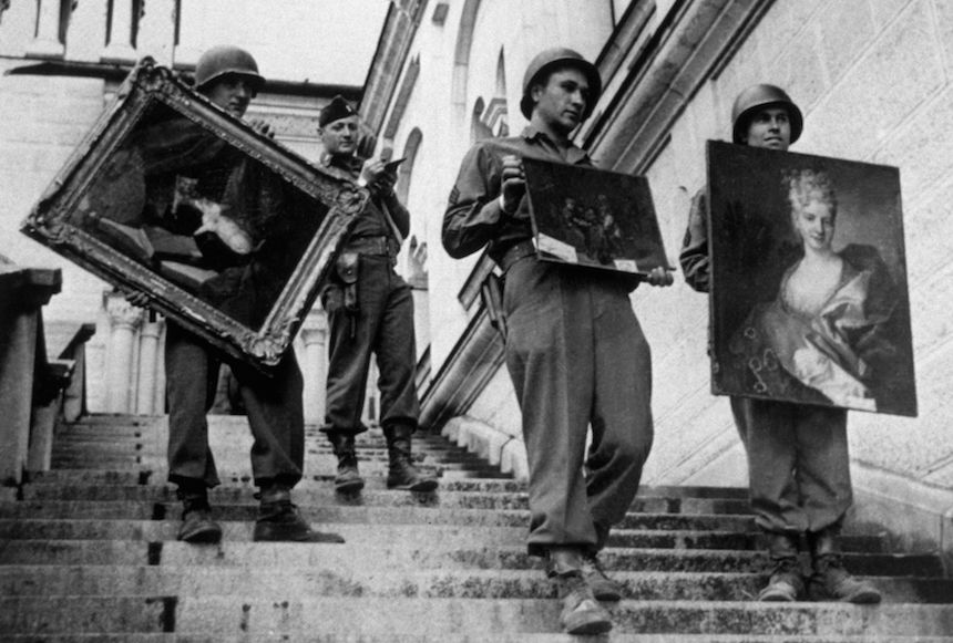 May 1945:  US soldiers carrying some of the priceless collection of paintings discovered in an Austrian castle. The Nazi loot was intended to go into a huge art gallery at Linz, in a plan devised by Goering.  (Photo by Keystone/Getty Images)