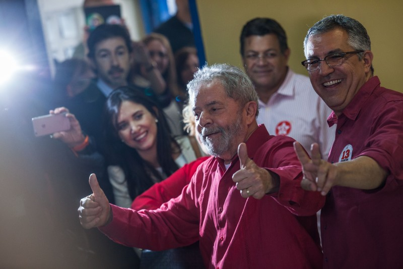 SAO BERNARDO DO CAMPO, BRAZIL - OCTOBER 5:  Former Brazil President Luiz Inacio Lula da Silva (C) gestures after voting during the first round of presidential elections on October 5, 2014  in Sao Bernardo do Campo, Brazil. Incumbent President Dilma Rousseff is competing against social democrat Aecio Neves and environmentalist Marina Silva with a run-off vote expected October 26. (Photo by Victor Moriyama/Getty Images)