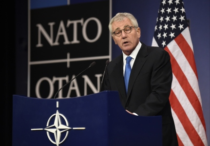 US Defence minister Chuck Hagel gives a press conference during a defence ministers meeting at the NATO headquarters in Brussels on February 5, 2015. NATO was set to agree a major boost to its defences including six bases in eastern Europe and a spearhead force of 5,000 troops in response to what it called Russian aggression in Ukraine. AFP PHOTO/JOHN THYS (Photo credit should read JOHN THYS/AFP/Getty Images)