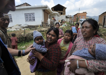 Nepalese residents bring their children to a UNICEF field clinic providing vaccinations at Kot Danda in Lalitpur in the Kathmandu Valley on May 6, 2015, following a 7.8 magnitude earthquake which struck the Himalayan nation on April 25. Emergency vaccinations are being given to thousands of children who survived the quake to save them from a potential outbreak of deadly diseases that could sweep through squalid tent cities where scores of families are living without proper shelter or sanitation. AFP PHOTO / PRAKASH MATHEMA (Photo credit should read PRAKASH MATHEMA/AFP/Getty Images)