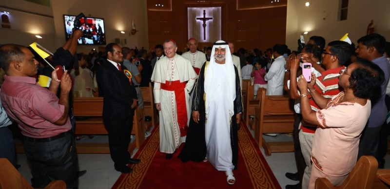UAE minister for youth, culture and community development Sheikh Nahayan bin Mubarak Al-Nahayan (C-L) and Vatican Secretary of State, Cardinal Pietro Parolin (C-R) attend the opening ceremony of the second Catholic Church dedicated to St Paul in Abu Dhabis industrial district of Musaffah on June 11, 2015. AFP PHOTO / STR        (Photo credit should read STR/AFP/Getty Images)