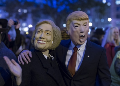 NEW YORK, NY - OCTOBER 31: People wearing the masks of presidential candidates Hillary Clinton and Donald Trump are seen during the 42nd Annual Halloween Parade on October 31, 2015 in New York City. (Photo by Bilgin S. Sasmaz/Anadolu Agency/Getty Images)
