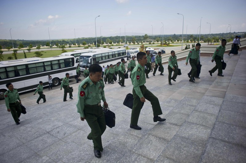 Myanmar military officials arrive for Myanmar's first parliament meeting after general elections, at the Lower House of Parliament in Naypyidaw on November 16, 2015. Myanmar's Aung San Suu Kyi returned to parliament November 16 along with dozens of rivals freshly hammered by her pro-democracy party's landslide election victory as the legislature begins a overseeing the country's delicate transition. AFP PHOTO / Ye Aung THU        (Photo credit should read Ye Aung Thu/AFP/Getty Images)
