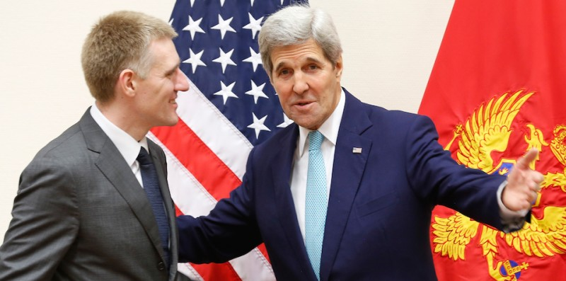 US Secretary of State John Kerry (2nd L) meets with Montenegro's Foreign Minister Igor Luksic during the NATO ministerial meetings at the NATO headquarters in Brussels on December 2, 2015 NATO foreign ministers on Wednesday invited Montenegro to join the US-led military alliance, a move Russia has repeatedly warned against as a threat to stability in the western Balkans. / AFP / POOL / JONATHAN ERNST        (Photo credit should read JONATHAN ERNST/AFP/Getty Images)