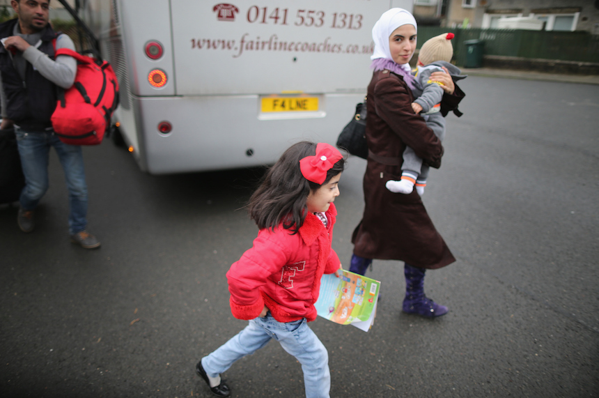 ROTHESAY, ISLE OF BUTE, SCOTLAND - DECEMBER 04:  Syrian refugee families arrive at their new homes on the Isle of Bute on December 4, 2015 in Rothesay, Isle of Bute, Scotland. The Isle of Bute is welcoming 15 Syrian Refugee families as part of the governments plant to give refuge to 20,000 refugees in the UK by 2020. The Isle of Bute, on the Cowal peninsular, has a population of 6,498 which swells in the Summer months due to tourism. The island has been nicknamed the 'Madeira of Scotland'  (Photo by Christopher Furlong/Getty Images)