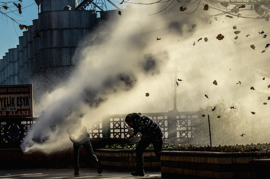 TOPSHOT - Turkish riot police use water cannon to disperse protestors from Diyarbakir's historical Sur district which has been placed under a curfew, on December 6, 2015 in Diyarbakir.  More than a week after prominent Kurdish lawyer Tahir Elci was killed in broad daylight in a street in southeastern Turkey's main city, the Turkish authorities appear no closer to solving the crime amid bitter recriminations over who was to blame. / AFP / ILYAS AKENGIN        (Photo credit should read ILYAS AKENGIN/AFP/Getty Images)