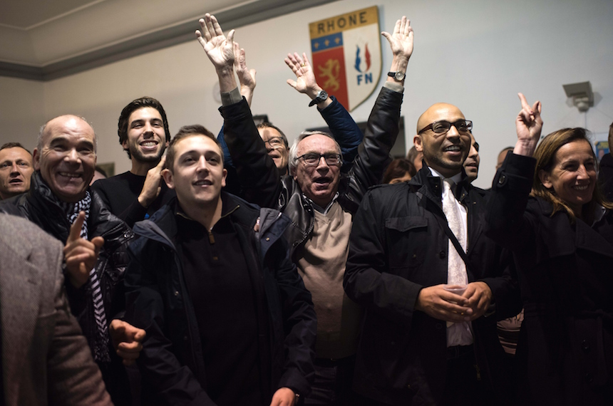 Supporters of French Front National far-right party top candidate Christophe Boudot watch the results of the first round of the regional election in Rhone-Alpes-Auvergne region on December 6, 2015 in Lyon, central-eastern France. / AFP / ROMAIN LAFABREGUE        (Photo credit should read ROMAIN LAFABREGUE/AFP/Getty Images)