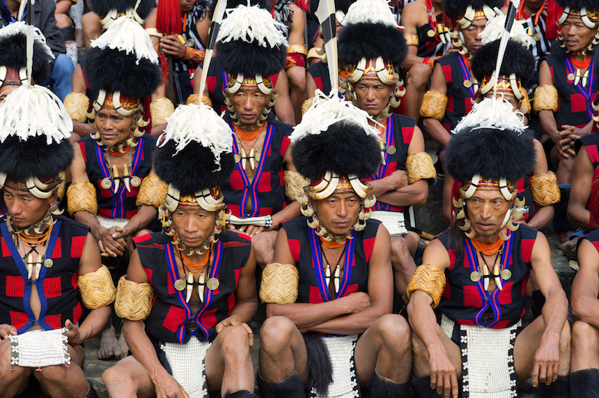 KISAMA, KOHIMA, NAGALAND, INDIA - 2015/12/04: To encourage inter-tribal interaction and to promote cultural heritage of all the sixteen tribes of Nagaland, the Government of Nagaland organizes the Hornbill Festival every year in the first week of December. The festival was first held in the year 2000. It is named after the Indian hornbill, the large and colourful bird which is much admired by the tribes of the state. Hornbill festival is held at the Naga Heritage Village in Kisama, some twelve kilometers away from the state capital, Kohima. All the tribes of Nagaland take part in this festival. For visitors the festival offers an opportunity to understand the tribal culture of Nagaland. The Traditional Naga Morungs and the sale of indigenous artifacts provide additional attraction. (Photo by Subhendu Sarkar/LightRocket via Getty Images)
