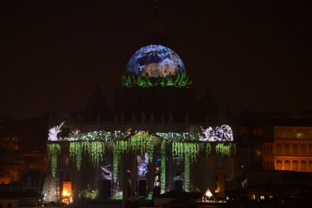 A picture is projected on the facade and the cupola of St. Peters Basilica during the show Fiat Lux : Illuminating Our Common Home, on December 8, 2015 at the Vatican. Images by some of the world's greatest environmental photographers, including Sebastião Salgado, Joel Sartore, Yann Arthus-Bertrand and Louie Schwartzberg, are projected in solidarity with COP21 talks in Paris. It is also part of the inauguration of the Roman Catholic Churchs yearlong Jubilee of Mercy, which starts today. AFP PHOTO / FILIPPO MONTEFORTE / AFP / FILIPPO MONTEFORTE (Photo credit should read FILIPPO MONTEFORTE/AFP/Getty Images)