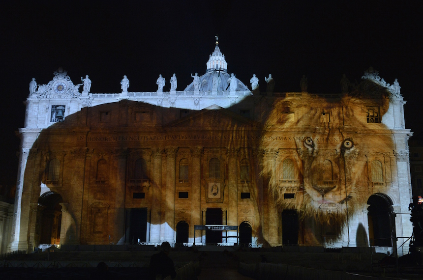 A picture is projected on St. Peters Basilica during the show Fiat Lux : Illuminating Our Common Home, on December 8, 2015 at the Vatican. Images by some of the world's greatest environmental photographers, including Sebastião Salgado, Joel Sartore, Yann Arthus-Bertrand and Louie Schwartzberg, are projected in solidarity with COP21 talks in Paris. It is also part of the inauguration of the Roman Catholic Churchs yearlong Jubilee of Mercy, which starts today.   / AFP / TIZIANA FABI        (Photo credit should read TIZIANA FABI/AFP/Getty Images)