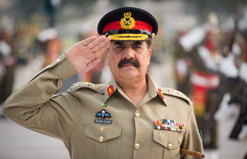 The supreme commander of the Pakistani army General Raheel Sharif salutes as he inspects a military honor guard at the Pakistani army's headquarters in Islamabad on December 9, 2015.     AFP PHOTO / POOL / KAY NIETFELD / AFP / POOL / KAY NIETFELD        (Photo credit should read KAY NIETFELD/AFP/Getty Images)