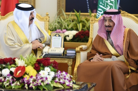 Saudi King Salman bin Abdulaziz (R) talks to Bahraini King Hamad bin Isa al-Khalifa upon the latters arrival to attend the 136th Gulf Cooperation Council (GCC) summit, in the Saudi capital Riyadh, on December 9, 2015. Gulf monarchs began arriving in Saudi Arabia for an annual summit, facing challenges including plunging oil revenues, the war in Yemen, pressure for peace in Syria and signs of regional divisions. / AFP / FAYEZ NURELDINE (Photo credit should read FAYEZ NURELDINE/AFP/Getty Images)