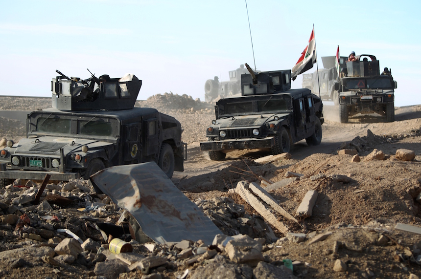 Iraqi counter-terrorism forces drive in the Tameem district of Ramadi, a large city on the Euphrates 100 kilometres (60 miles) west of Baghdad on December 9, 2015. Iraqi forces consolidated newly gained positions in Ramadi, after achieving a breakthrough in their fight against the Islamic State (IS) group by retaking a large part of the city. AFP PHOTO / AHMAD AL-RUBAYE / AFP / AHMAD AL-RUBAYE        (Photo credit should read AHMAD AL-RUBAYE/AFP/Getty Images)