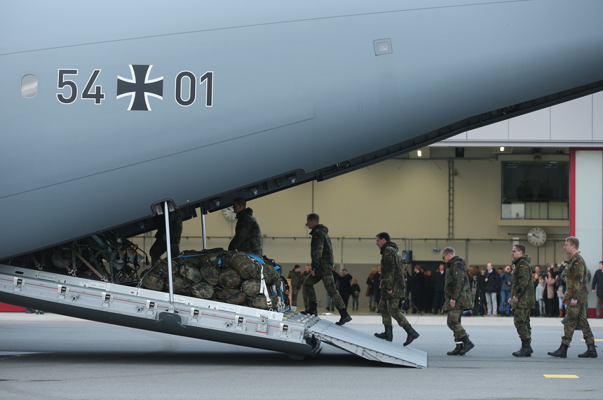 JAGEL, GERMANY - DECEMBER 10:  Forty members of the Bundeswehr, the German armed forces, board a Luftwaffe A-400M transport plane destined for Incirlik airbase in Turkey as part of Germany's participation in the international military intervention against the Islamic State (IS) in Syria on December 10, 2015 in Jagel, Germany. Germany is sending a total of 1,200 troops, six Tornado reconaissance jets and a navy frigate in non-combative roles.  (Photo by Sean Gallup/Getty Images)