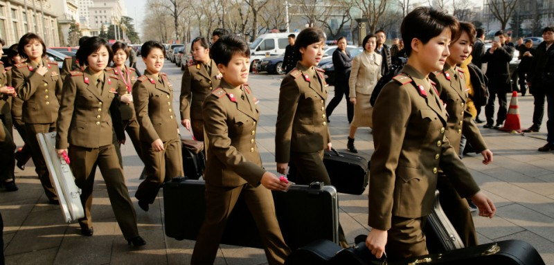 BEIJING, CHINA - DECEMBER 11: (CHINA OUT) Members of the North Korean female music group Moranbong Band leave the hotel for concert rehearsal on December 11, 2015 in Beijing, China. The Moranbong Band will perform at the National Centre for the Performing Arts from December 12 to 14. (Photo by ChinaFotoPress)***_***