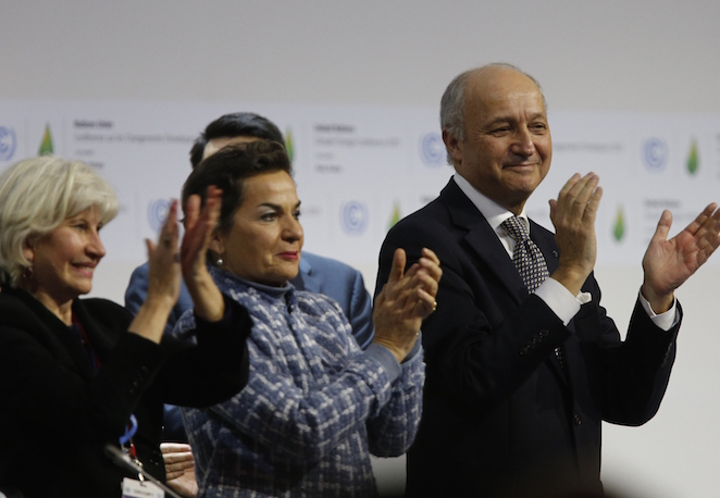 (L-R) French Ambassador for the international Climate Negotiations Responsible for COP21 Laurence Tubiana, Executive Secretary of the United Nations Framework Convention on Climate Change (UNFCCC) Christiana Figueres and Foreign Affairs Minister and President-designate of COP21 Laurent Fabius clap after adoption of a historic global warming pact at the COP21 Climate Conference in Le Bourget, north of Paris, on December 12, 2015. Envoys from 195 nations on December 12 adopted to cheers and tears a historic accord to stop global warming, which threatens humanity with rising seas and worsening droughts, floods and storms. AFP PHOTO / FRANCOIS GUILLOT / AFP / FRANCOIS GUILLOT        (Photo credit should read FRANCOIS GUILLOT/AFP/Getty Images)