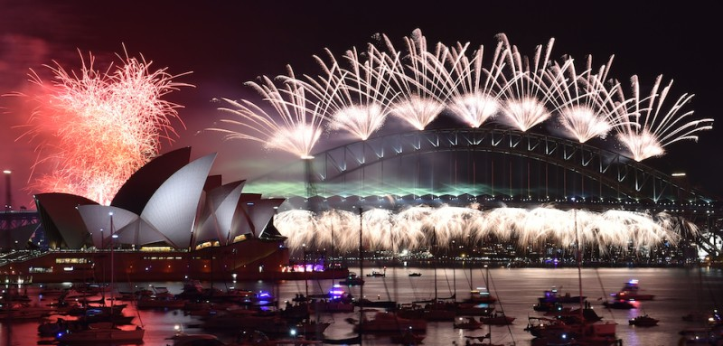 Fireworks light up the sky over Sydney's Opera House (L) and Harbour Bridge during New Year celebrations in Sydney on January 1, 2016.  AFP PHOTO / Saeed KHAN / AFP / SAEED KHAN        (Photo credit should read SAEED KHAN/AFP/Getty Images)