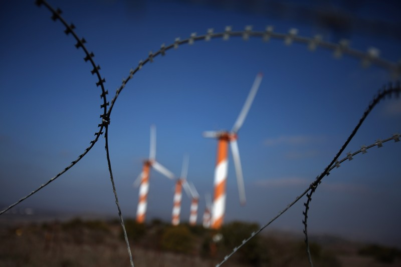 ALONEI HABASHAN, GOLAN HEIGHTS - NOVEMBER 27:  Coils of barbed-wire protect visitors from wandering into the minefields that surround the wind farm on Mount Bnei Rasan overlooking the border with Syria on November 27, 2009 near the Israeli community of Alonei Habashan in the Golan Heights. The ten wind turbines produce 6 megawatts of electricity which is used by local industry and the residents of the disputed plateau which Israel captured from Syria in the 1967 Six Day War. It was built in 1992 and was the first commercial wind-power project in the Middle East. The United Nations Climate Change Conference in Copenhagen, Denmark will take place between December 6-18 with representatives over 160 countries with the objective to prevent global warming and climate changes.  (Photo by David Silverman/Getty Images)
