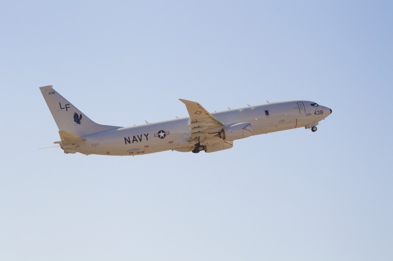 A United States Navy Boeing P-8 Poseidon takes off from Perth International Airport as part of the search to locate missing Malaysia Airways Flight MH370 on April 15, 2014. A mini-sub hunting for Malaysian jet MH370 prepared to make a second mission to the remote Indian Ocean seabed on April 15 after aborting its first search as it encountered water deeper than its operating limits, officials said. AFP PHOTO / Richard Wainwright / POOL        (Photo credit should read RICHARD WAINWRIGHT/AFP/Getty Images)