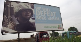 """A photo shows a campaign signboad displayed by the ruling All Progressives Congress (APC) to show its readiness to defeat Boko Haram Islamists on assumption office at Ogijo, Ogun State in southwest Nigeria, on July 3, 2015. Boko Haram carried out a fresh wave of massacres in northeastern Nigeria on July 3, locals said, killing nearly 200 people in 48 hours of violence President Muhammadu Buhari blasted as """"inhuman and barbaric"""". AFP PHOTO / PIUS UTOMI EKPEI        (Photo credit should read PIUS UTOMI EKPEI/AFP/Getty Images)"""