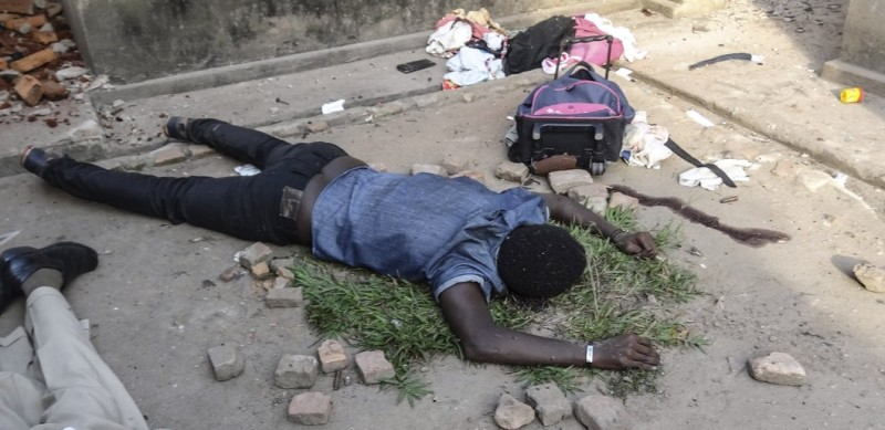Bodies lie in the streets of Mutakura in Bujumbura on July 1, 2015, after a tense day of shooting. At least six people including a policeman were killed in gun battles on July 1 in the latest violence in Burundi, as it awaits results from elections boycotted by the opposition and condemned internationally. Clashes broke out in the capital's Cibitoke district, an opposition area that has been one of the heartlands of protests against President Pierre Nkurunziza's defiant bid for a third term. AFP PHOTO / ESDRAS NDIKUMANA        (Photo credit should read Esdras Ndikumana/AFP/Getty Images)