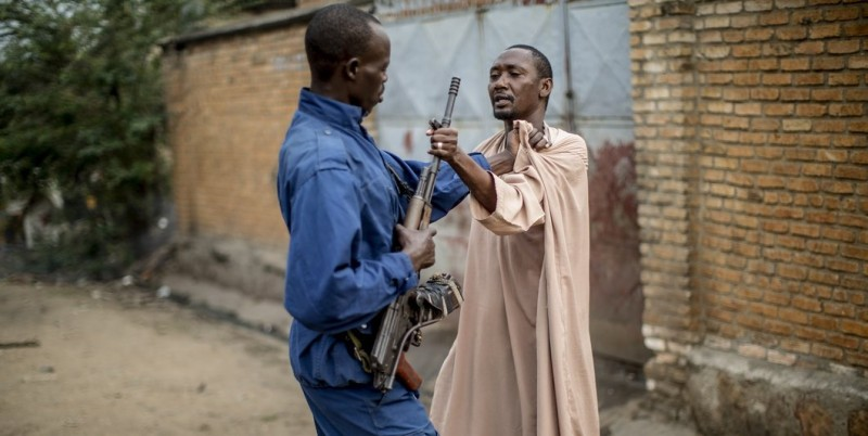A man grabs the barrel of the weapon from a Burundi policeman  during a scuffle with residents angered by a search operation in the of the Cibitoke neighbourhood of Bujumbura on June 27, 2015.  AFP PHOTO/MARCO LONGARI        (Photo credit should read MARCO LONGARI/AFP/Getty Images)