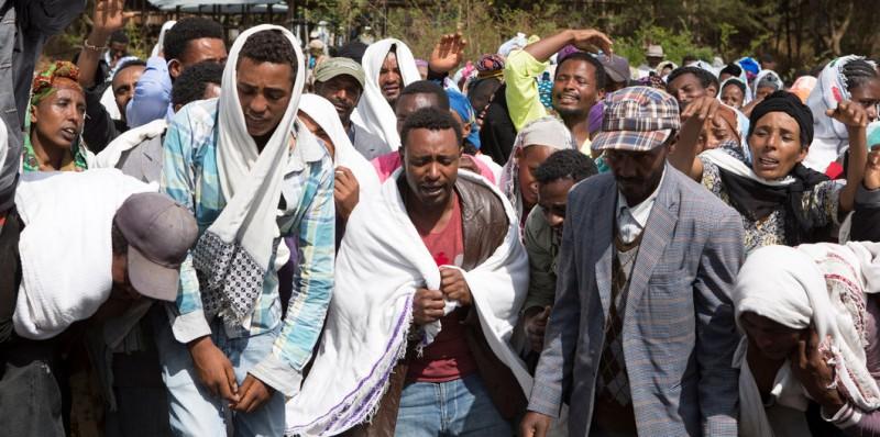 People mourn the death of Dinka Chala who was shot dead by the Ethiopian forces the day earlier, in the Yubdo Village, about 100 km from Addis Ababa in the Oromia region, on 17 December 2015.  Dinka Chala was accused of protesting, but his family says he was not involved. Tensions have been riding high between the population of Oromia and the Federal Government of Ethiopia. The population of Oromia are unhappy with the current Master Plan which is overtaking Oromo lands surrounding Addis Ababa. The protests have been ongoing for the past three weeks, with government responding in force with live ammunition. The Government also claims death tolls of around 5, the unofficial figure made by protesters has reached up to 40+.  / AFP / ZACHARIAS ABUBEKER        (Photo credit should read ZACHARIAS ABUBEKER/AFP/Getty Images)