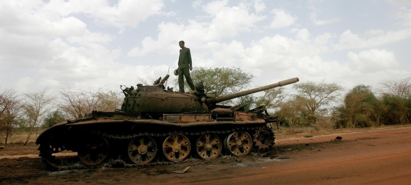 A Sudanese soldier stands atop a destroyed tank for the Sudanese Peoples Liberation Army (SPLA) of South Sudan in the oil region of Heglig on April 23, 2012. Sudanese President Omar al-Bashir said during his visit to Heglig that there will be no more talks with South Sudan after weeks of border fighting in contested regions and tension between the two states. AFP PHOTO/ASHRAF SHAZLY        (Photo credit should read ASHRAF SHAZLY/AFP/GettyImages)