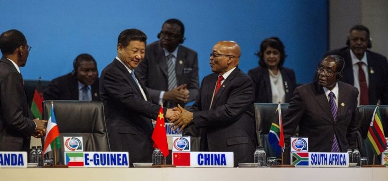 Chinese President Xi Jinping (L) shakes hands with South African President Jacob Zuma after their speech during the opening session of the Forum on Africa and China Cooperation at Sandton, in Johannesburg, on December 4, 2015. Chinese President Xi Jinping announced $60 billion of assistance and loans for Africa at a summit in Johannesburg on Friday, signalling China's commitment to the continent despite a recent fall in investment.  / AFP / MUJAHID SAFODIEN        (Photo credit should read MUJAHID SAFODIEN/AFP/Getty Images)