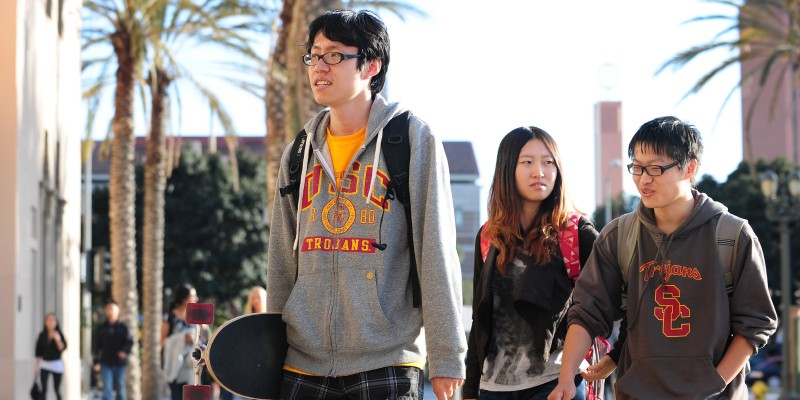 USC students on their way to attend a memorial service on April 18, 2012 in Los Angeles, California, for the two Chinese graduate students who were shot to death near campus last week. US authorities have offered $200,000 in reward money to find whoever killed the two students, after more funds were pledged on April 17.  Los Angeles has a large Chinese and Chinese-American population, including many overseas students and certain areas of the city are known for frequent gun violence. AFP PHOTO/Frederic J. BROWN (Photo credit should read FREDERIC J. BROWN/AFP/Getty Images)