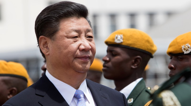 Chinese President Xi Jinping inspects the guard of honour following his arrival in Harare where China and Zimbabwe are scheduled to sign various economic deals in agriculture, energy and infrastructure development December 1 2015.  China's President Xi Jinping started a five-day visit to Zimbabwe and South Africa, with African concern over the impact of the Chinese economic slowdown set to dominate the agenda. Xi will be the most prominent global leader to visit Zimbabwe for many years as veteran President Robert Mugabe, 91, is widely shunned by Western powers.  / AFP / JEKESAI NJIKIZANA        (Photo credit should read JEKESAI NJIKIZANA/AFP/Getty Images)
