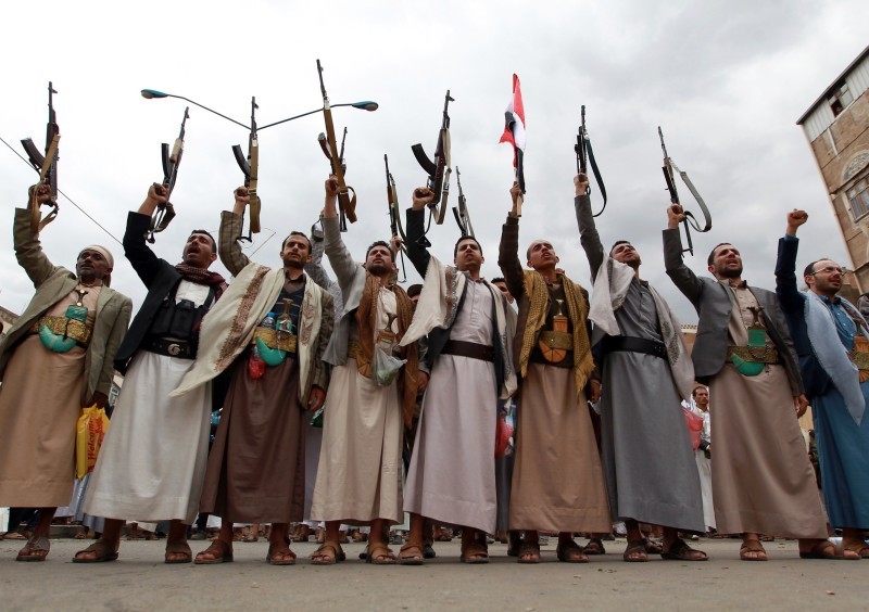"Tribal gunmen loyal to the Huthi movement brandish their weapons on March 26, 2015 during a gathering in Sanaa to show support the Shiite Huthi militia and against the Saudi-led intervention in the country. Warplanes from a Saudi-led Arab coalition bombed Huthi rebels in support of Yemen's embattled president, as regional rival Iran warned the intervention was a ""dangerous"" move. AFP PHOTO / MOHAMMED HUWAIS        (Photo credit should read MOHAMMED HUWAIS/AFP/Getty Images)"