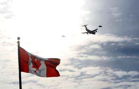 The plane carrying the last of Canada's troops in Afghanistan is escorted through the air by fighter jets, after the last Canadian troops from Afghanistan returned to Ottawa International Airport on March 18, 2014 in Ottawa, Ontario. Eighty-four armed forces members were welcomed home marking the end of Canada's  participation in the Afghanistan war, a mission that spanned 12 years.     AFP PHOTO/ Cole Burston        (Photo credit should read Cole Burston/AFP/Getty Images)