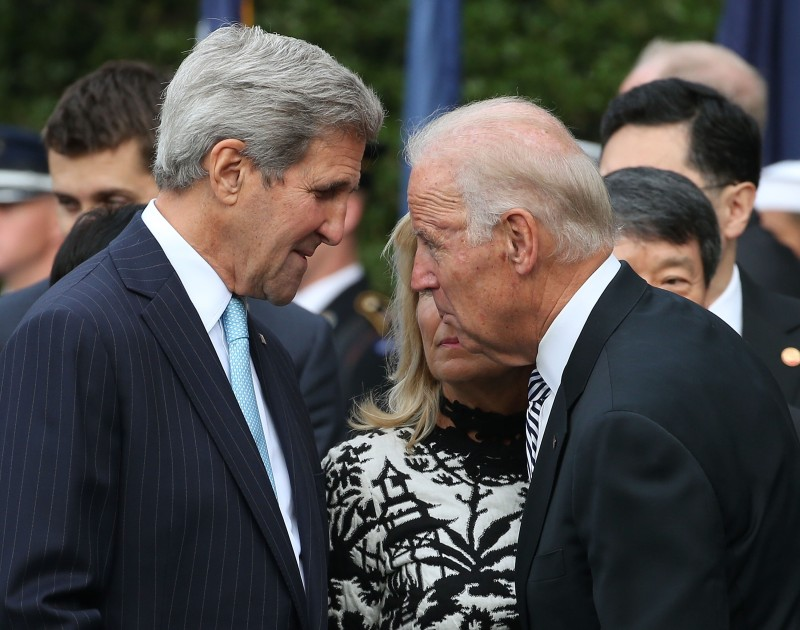 WASHINGTON, DC - SEPTEMBER 25:  US Vice President Joseph Biden (R) talks with US Secretary of State John Kerry (L) as his wife wife Dr. Jill Biden listens, during an arrival ceremony for Chinese president Xi Jinping at the White House September 25, 2015 in Washington, DC. President Obama officially welcoming President Jinping during a state arrival ceremony followed by a joint news conference news conference later in the day.  (Photo by Mark Wilson/Getty Images)