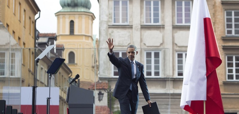 US President Barack Obama waves after speaking at the 25th Anniversary Freedom Day Event in honor of the 25th anniversary of the first partly-free parliamentary elections in the Royal Square in Warsaw, Poland on June 4, 2014. Adopting the mantle of 'leader of the West' Obama hailed Poland for building a thriving democracy 25 years after elections which fractured communism as part of a European tour dedicated to bolstering NATO defenses and resolve.  AFP PHOTO / Saul LOEB        (Photo credit should read SAUL LOEB/AFP/Getty Images)