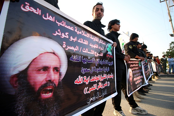 Shiite Muslim Iraqis, including supporters of the Shiite group Asaib Ahl al-Haq (The League of the Righteous), hold banners bearing portraits of prominent Shiite cleric Nimr al-Nimr during a demonstration in the Iraqi mainly Shiite southern city of Basra on January 6, 2016 against al-Nimr's execution by Saudi authorities in Saudi Arabia last week. AFP PHOTO / HAIDAR MOHAMMED ALI / AFP / HAIDAR MOHAMMED ALI        (Photo credit should read HAIDAR MOHAMMED ALI/AFP/Getty Images)