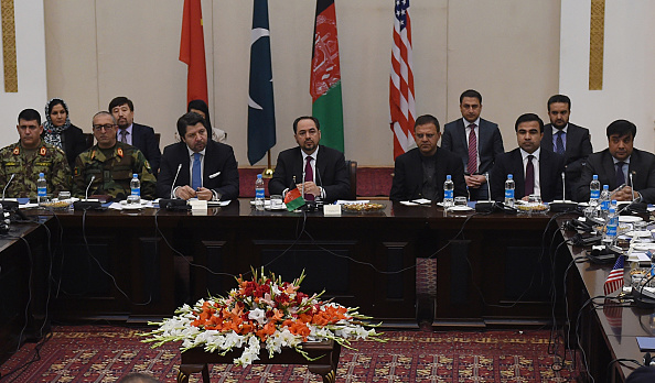 Afghan Foreign Minister, Salahuddin Rabbanion (C) chairs the second round of four-way peace talks at the Presidential palace in Kabul on January 18, 2016.  A second round of four-country talks aimed at reviving peace negotiations with the Taliban began in Kabul on January 18, even as the insurgents wage an unprecedented winter campaign of violence across Afghanistan. Delegates from Afghanistan, Pakistan, China and the United States convened in the Afghan capital for a one-day meeting seeking a negotiated end to the bloody 14-year insurgency.  AFP PHOTO / SHAH Marai / AFP / SHAH MARAI        (Photo credit should read SHAH MARAI/AFP/Getty Images)
