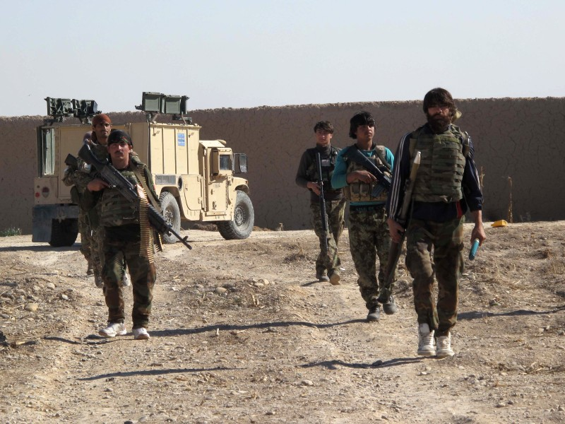 Afghan National Army (ANA) soldiers walk in Helmand on December 21, 2015.  Clashes intensified on December 21 as the Taliban pressed an offensive to capture a key district in Helmand, a day after an official warned that the entire southern province was on the brink of collapse.  Local residents reported crippling food shortages in Sangin district, heartland of the opium harvest and long seen as a hornet's nest of insurgent activity, after the Taliban began storming government buildings on December 20.   AFP PHOTO / Noor Mohammad / AFP / NOOR MOHAMMAD        (Photo credit should read NOOR MOHAMMAD/AFP/Getty Images)