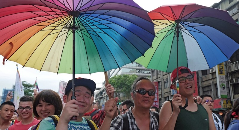 Actvists carry rainbow umbrellas during a demonstration outside the ruling Kuomintang (KMT) to demand rights on same-sex marriages in Taipei on July 11, 2015.  Hundreds of people marched in Taiwan in support for a controversial bill on same-sex marriage under screening in parliament. AFP PHOTO / Sam Yeh        (Photo credit should read SAM YEH/AFP/Getty Images)