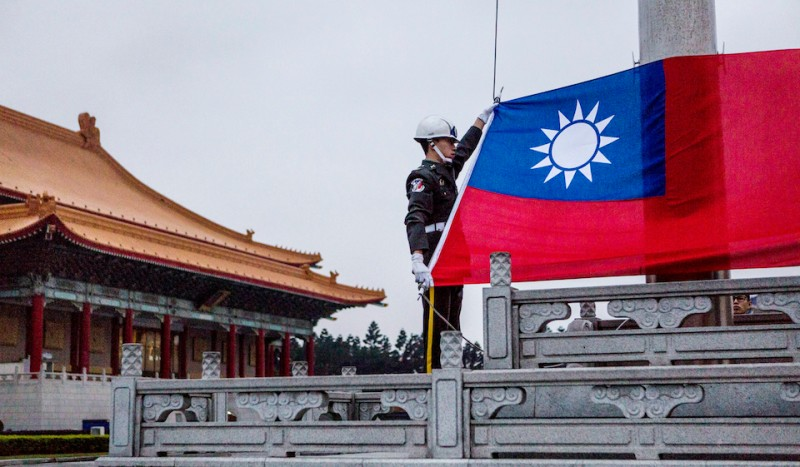TAIPEI, TAIWAN - JANUARY 14:  Honor guards prepare to raise the Taiwan flag in the Chiang Kai-shek Memorial Hall square ahead of the Taiwanese presidential election on January 14, 2016 in Taipei, Taiwan. Voters in Taiwan are set to elect Tsai Ing-wen, the chairwoman of the opposition Democratic Progressive Party, to become the island's first female leader.  (Photo by Ulet Ifansasti/Getty Images)